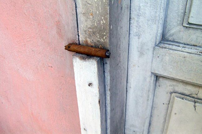 Tio's Cigar on Abuela's Door © 2002 by Lili Bernard