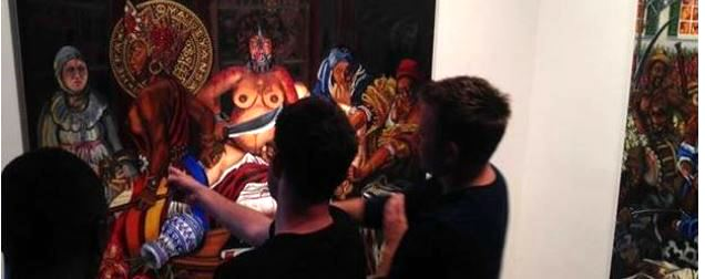 Art gallery goers discuss my painting, Carlota Slaying the Slaver at Walter Maciel Gallery, Culver City, CA, August 2014