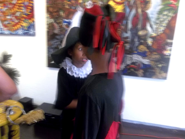 My sons Joshua as Santo Niño de Atocha and Uriel as Elegua