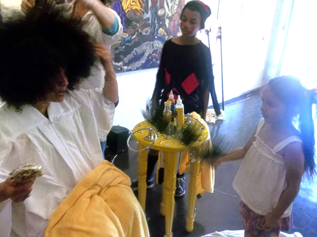 Volunteers fan me and dry my hair to reveal my natural Afro, per Elegua's delight.