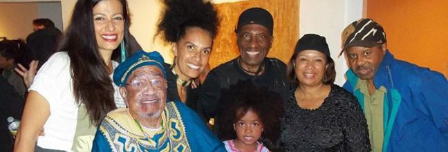 Opening reception of Colonialism: The Collective Unconscious at the William Grant Still Art Center, Los Angeles.  Left to right: Amitis Motevalli (center director), Cecil Ferguson (R.I.P. first Black curator at Los Angeles County Museum of Art), Lili Bernard (curator and artist in show) and daughter Zion, John Outterbridge (artist in show), guest and Greg Pitts (artist and art critic).
