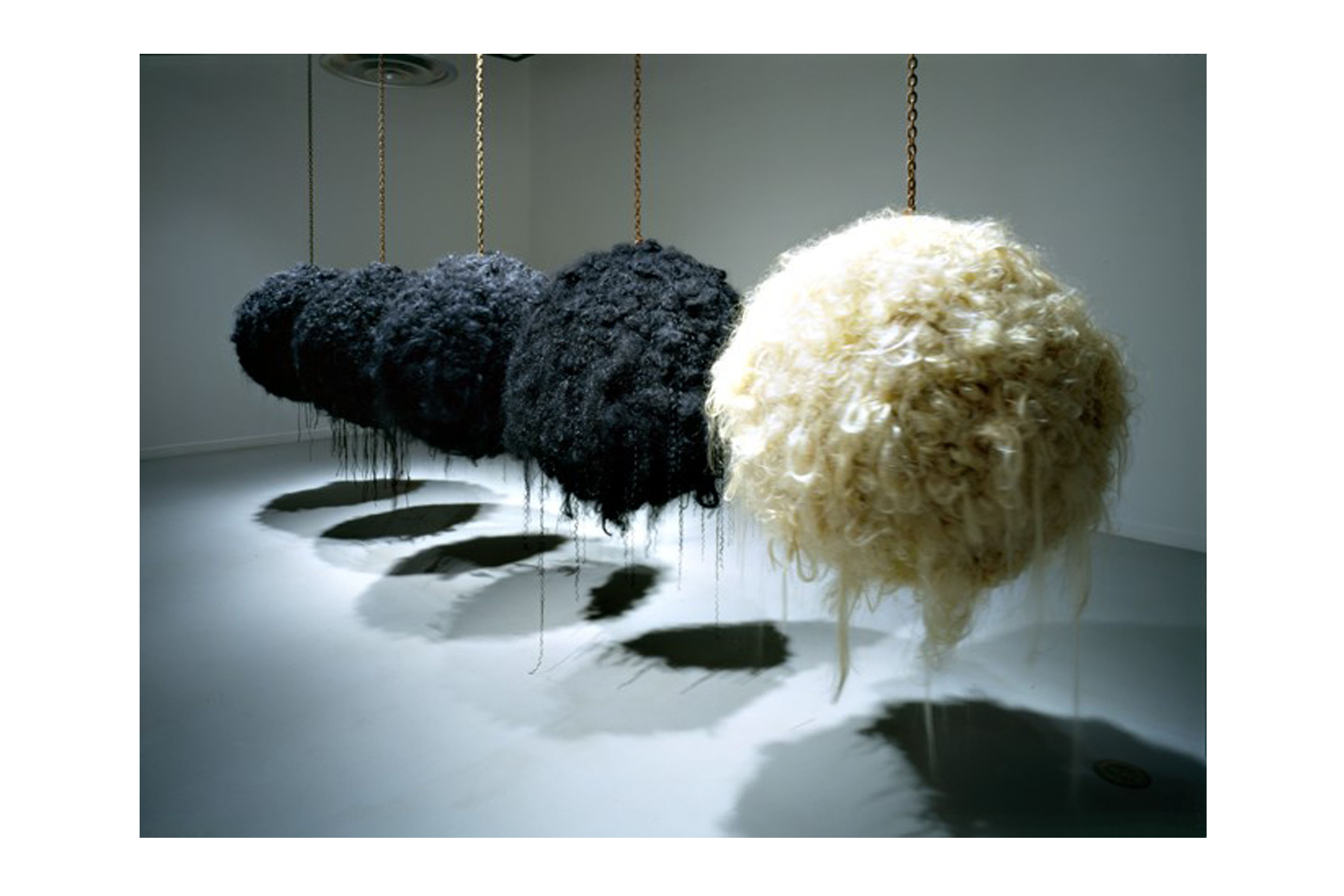 "Castillo. Excentricidad Ecliptica (Ecliptic Eccentricity) Installation View, 2000, Synthetic Hair, Rusted Chain, 36"" x 36"" x 36"""
