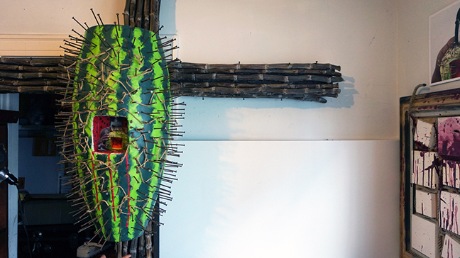 A detail of her piece Ain't Funny Crucifix, 2014, constructed from purple sugarcane, conga drum, nails, rope, acrylic paint, and watermelon seeds.