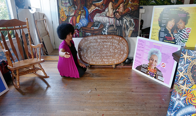 Bernard with some of her art, which spills out from her studio into her living room.