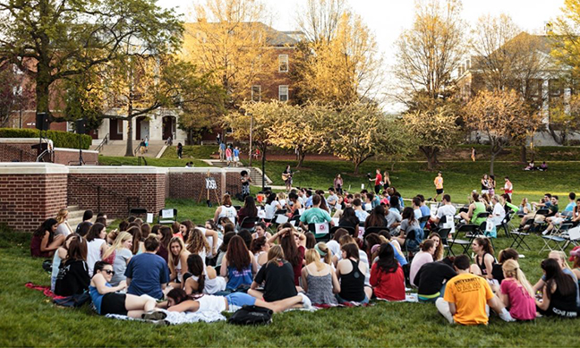 Students sit on McKeldin Mall on April 18 to raise awareness for sexual assault. (Tom Hausman/The Diamondback)